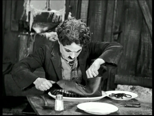 La Kitchenette de Miss Tâm Chaplin scène soulier dans la Ruée vers l'Or 1925